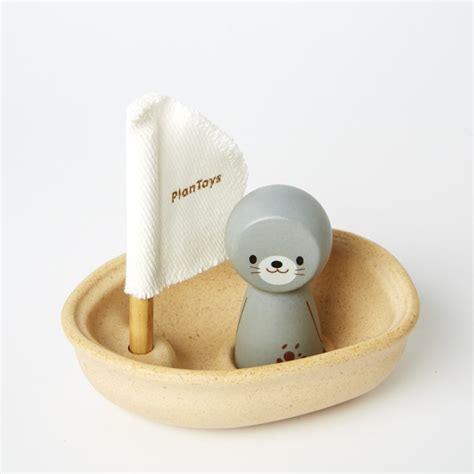 sailing boat bath toy plan toys sailing boat with seal wooden bath toy
