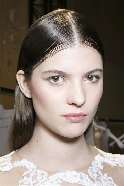 middle part hair tucked behind ears the hair trend from the couture runways we can t wait to