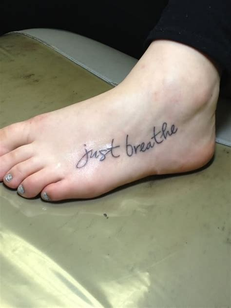 tattoo lettering on foot 37 awesome breathe tattoos