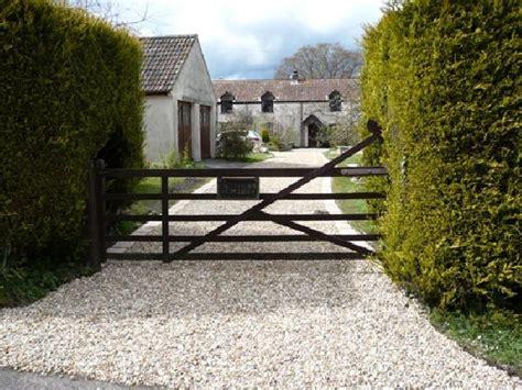 gravel driveway  love  bushes driveway entrance