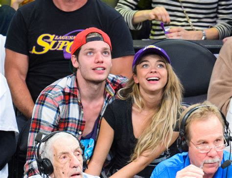 sarah hyland and dominic sherwood captured on kisscam