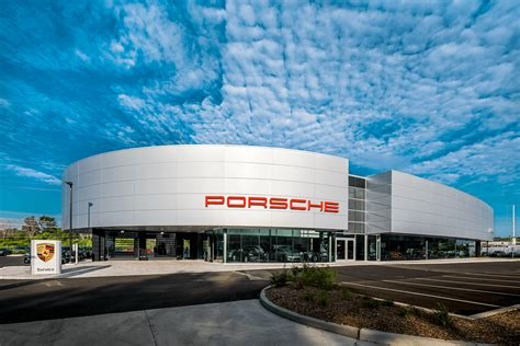 porsche dealership porsche exchange announces the grand opening of their
