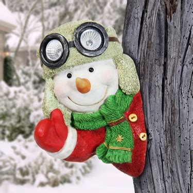 how to make a snowman tree hugger solar snowman tree hugger only 29 99 at garden