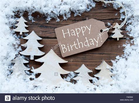 Snow Happy label trees and snow happy birthday stock photo