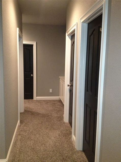 greige walls and black doors to find a photo with carpet seems everyone has wood floors