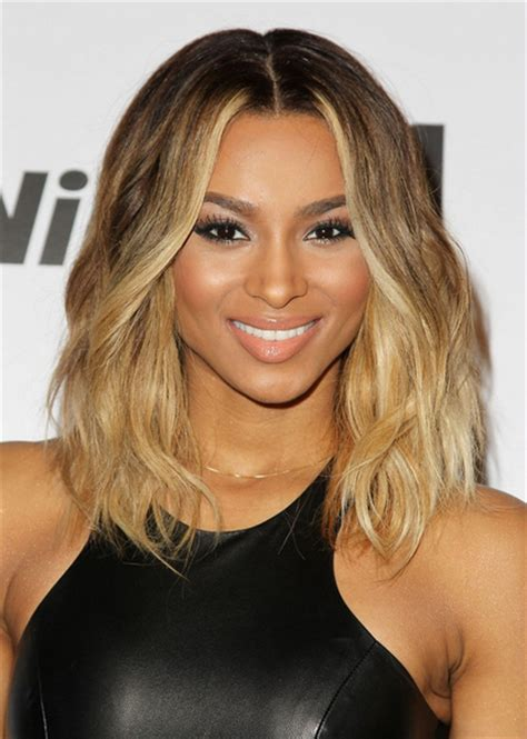 3 hairstyles to show off this season s statement earrings ciara shows off shoulder length hairstyle the