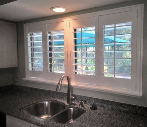 kitchen window shutters interior plantation shutters wood window interior designs