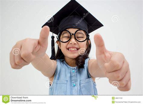 bid up happy asian school kid graduate in graduation cap stock