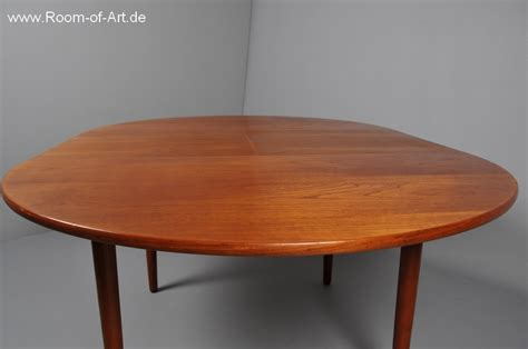 quality dining table in solid teak room of