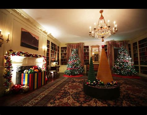 holiday decorations are seen in the library of the white