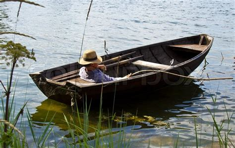 ship license mediah rowboat fisherman relaxing in old row boat stock photo colourbox