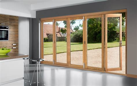 Bi Folding Doors Exterior Bi Fold Glass Exterior Doors With Wooden Frame For Large Kitchen With White And Gray Wall