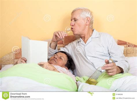 couples in bed images funny senior couple in bed royalty free stock images image 31489299