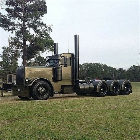 od green peterbilt shameful paint scheme on a sharp trick triaxle battle wagon