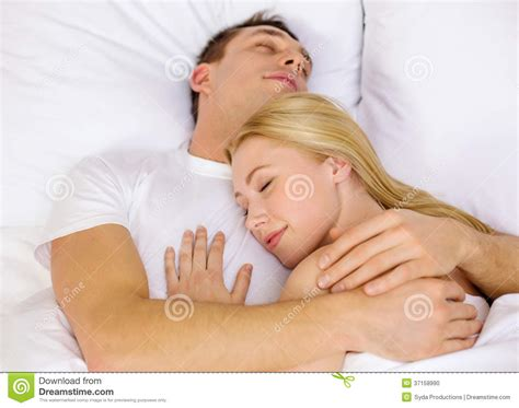 happy sleeping in bed stock photo image 37158990