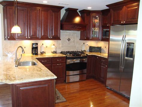kitchen flooring ideas with cherry cabinets www