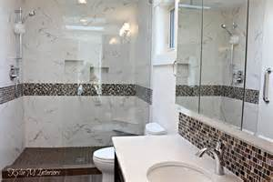 walk in shower in bathroom with pink and brown mosaic tile