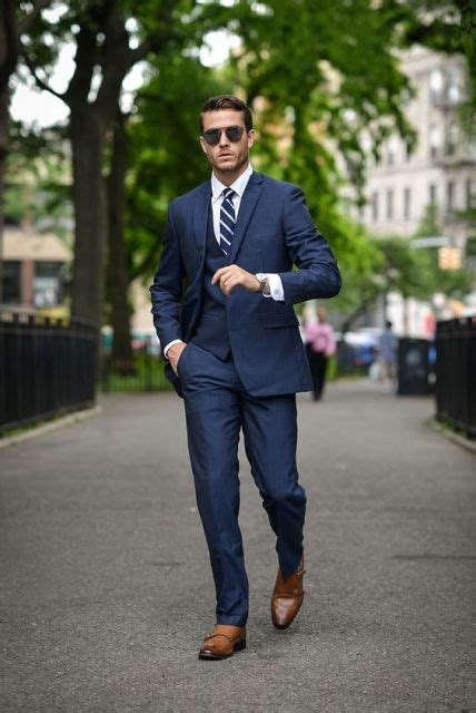 black man style guide picture of with navy blue suit white shirt and striped tie