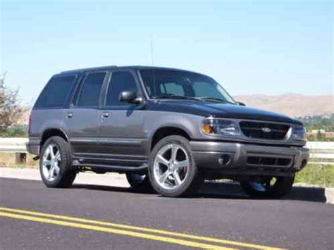 ford explorer custom two tone, with a supercharged 302