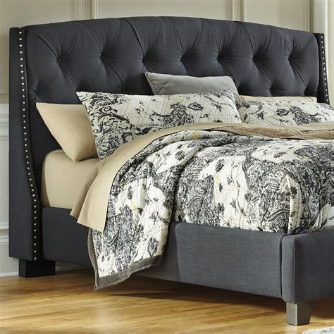 gray upholstered headboard king king california king upholstered headboard in gray with tufting and nailhead trim by