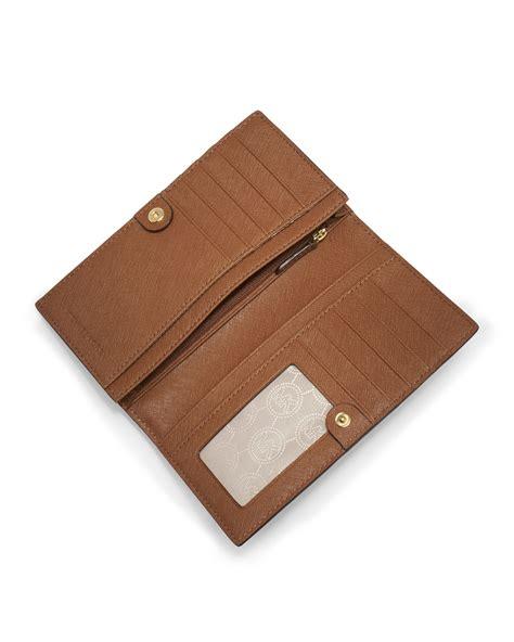 Michael Kors Travel Wallet 7 michael michael kors brown large jet set slim travel wallet lyst