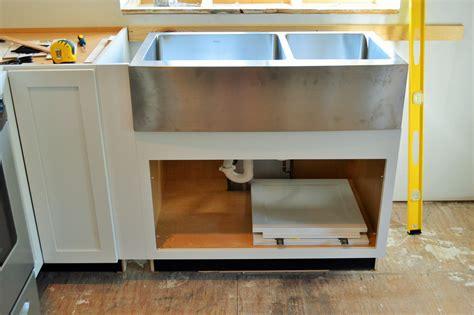 diwyatt adjusting the apron sink base before