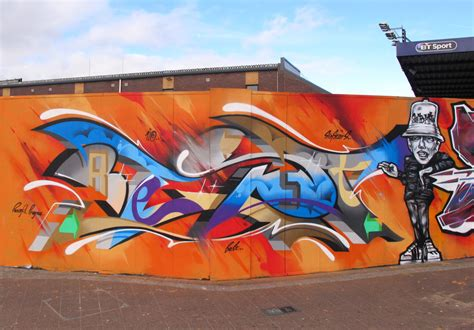 popular graffiti peaceful progress graffiti cardiff wales uk