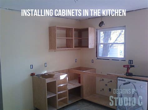 installing cabinets in the kitchen designs by studio c