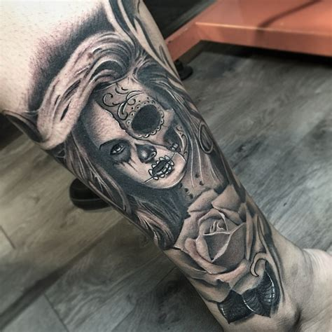 40 Eye Catching Day Of The Dead Tattoos Faces Skulls Daring Images Of Day Of The Dead Tattoos