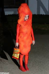 Katy perry wears a flamin hot cheeto costume for halloween photos