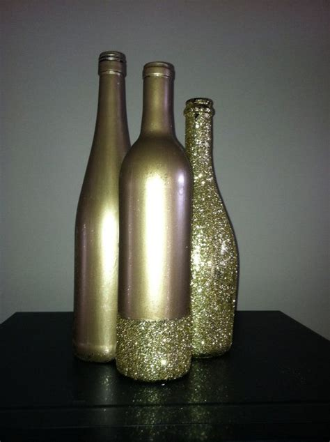 gold glittered wine bottles  southernlycrafted  etsy