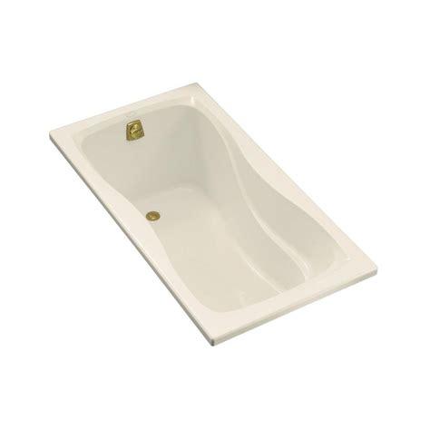 what is a reversible drain bathtub kohler hourglass 5 ft reversible drain acrylic bathtub in biscuit k 1219 96 the