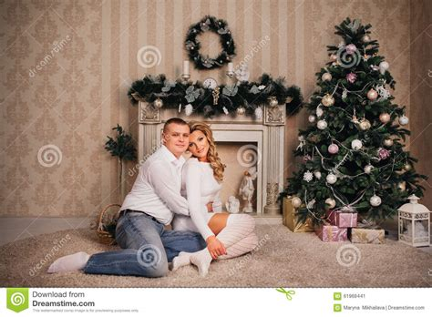 happy family sitting near christmas tree stock photo