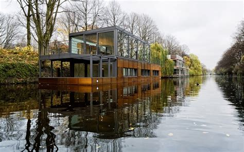 full house boat modern floating boat house is full of steel and wood pics