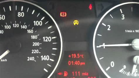yellow warning triangle sign on 2007 bmw 328i autos post