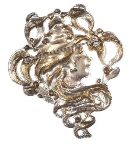 Metal Brooch silver tone metal brooch in the style of nouveau