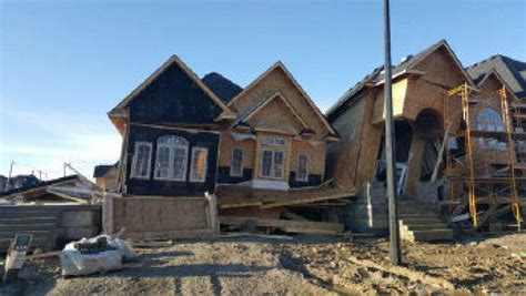 pushes half built homes in brton toronto