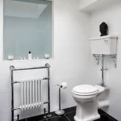 classic white bathroom with black floor tiles bathroom