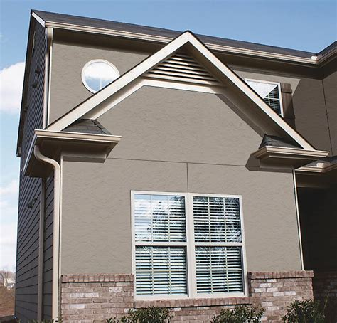 stucco vs hardie siding nichiha stucco and grooved 8 inch on center vertical