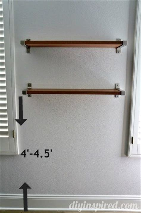 how high to hang a picture the right height to hang shelves diy inspired