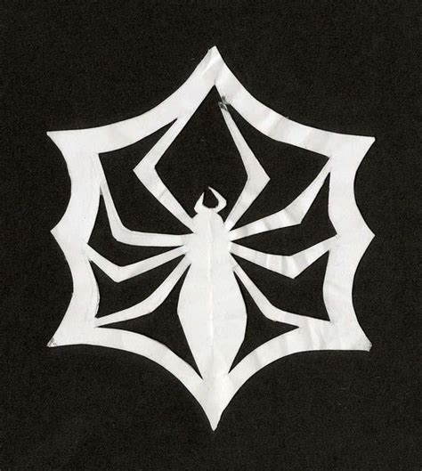 How To Make Spider Webs Out Of Paper - skellington paper cut out spider web snowflake from