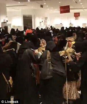dozens of women go nuts for a clothes sale in saudi arabia