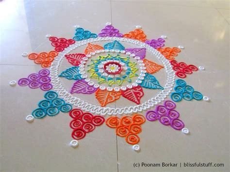 Handmade Rangoli Designs - award winning rangoli designs for diwali with diya
