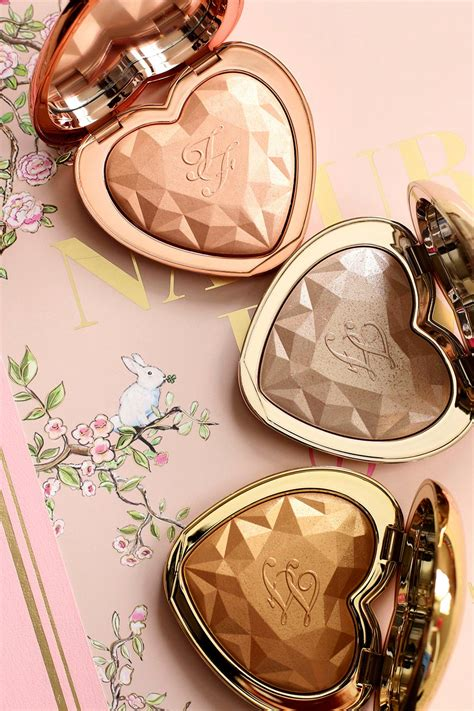 too faced love light highlighter swatches the new too faced love light prismatic highlighters in ray