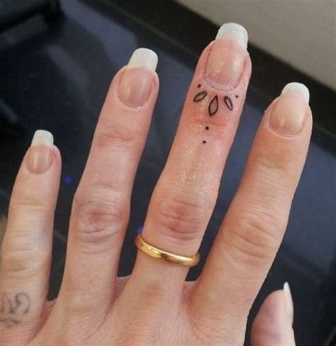 finger tattoo uk 50 delicate and tiny finger tattoos to inspire your first