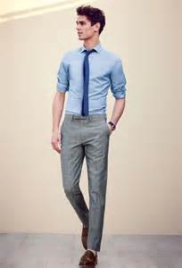 Grey slacks with slim tie and blue shirt pictures photos and images