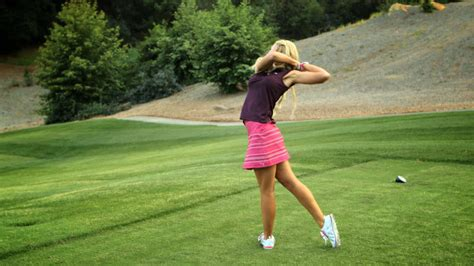 hitting or swinging golf blair o neal shows you how to hit your golf ball inside