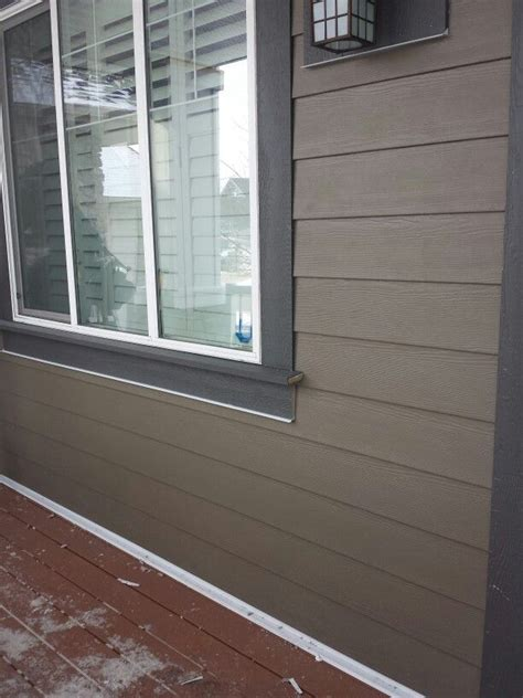 the exterior company ltd timberbark hardie siding with behr intellectual grey trims our