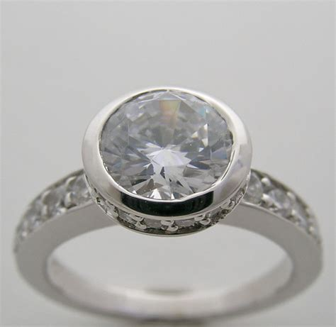 engagement ring setting with bezel accents