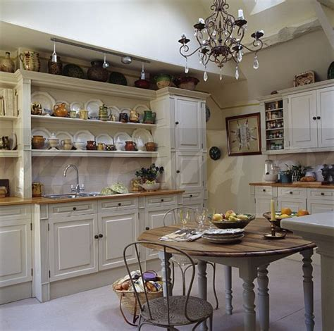 country kitchen extensions image chandelier above circular table and metal chairs in